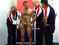 With all the anal stimulation, Guy's cock is leaking precum. This could prove to be a problem when he's out performing gymnastics shortly after this inspection. The only thing to do is wank off the hairy athlete. The star sportsman is humiliated as the older experienced men expertly manipulate his cock until he releases all of his pent-up semen.